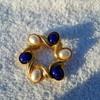 Vintage Gold-ish Napier Bracelet with luminous white and blue cabachons