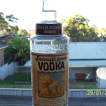 1 pint 6 fluid oz smirnoff vodka un opened, been in my possesion for many years now, recently un-earthed - Bottles