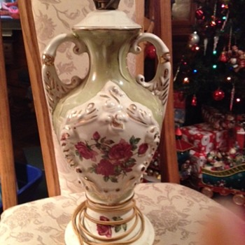 Antique rose painted urn lamp and were wondering the who the artist is???