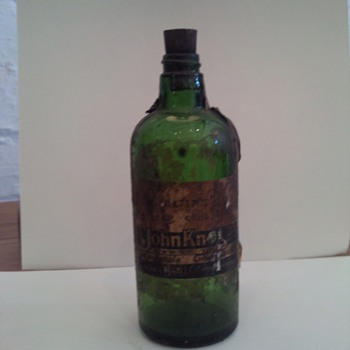 Dark Green Chemist Bottle with original lable,  - Bottles