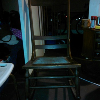 can anyone tell me about this old rocking chair
