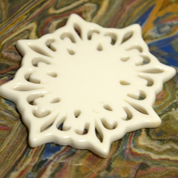 Very odd Milk Glass Coaster?