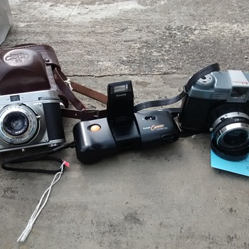 Film cameras three different era and different film formats, A Debonair, A Kodak 110 and a 1950's  Ideal Color 35