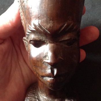Wood carved bust of an African woman
