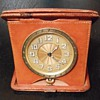 Antique Swiss made, 8 day, travel clock in leather case