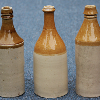 ---Large size Tan and White stone ware beer bottles---