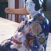Oriental Girl Holding Dog