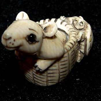 Three Netsuke and a Brush Rest