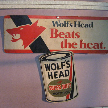 WOLF&#039;S HEAD OIL CARDBOARD SIGN - Petroliana