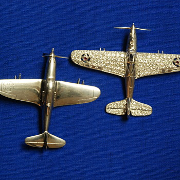 "LARRY BELL OF BELL AIRCRAFT -- SECRET P-39 AIRACOBRA BROOCHES IN ""TRUST"" AT  S-F N BANK OF L.A. AND PALM BEACH, FLA."