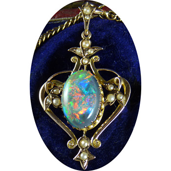 An Early Australian Lightning Ridge Solid Black Opal, in an Art Nouveau Pendant, by William Kerr