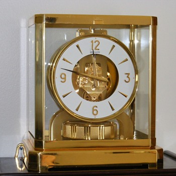 An amazing clock - almost perpetual motion (VERY close) - Clocks