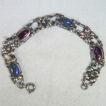 A Silver, Enamel, and Black Opal Bracelet by Elsie Reeve