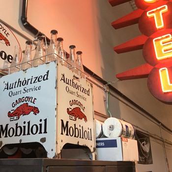 Antique gargoyle oil rack with matching glass bottles