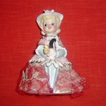 Ceramic figurine with fabric lace...