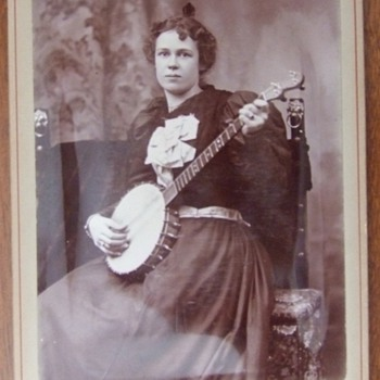 Cabinet card of a woman with her Banjo c. 1890