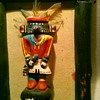 Kachina dolls, carved wooden walking stick