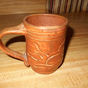 Art Pottery Mug relief and incised decoration Need help with mark.