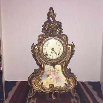 Rococo style gilt metal ansonia mantel clock with  cupid