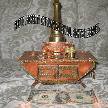 Miniature cook stove.