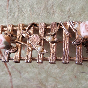 Picket Fence gold metal with porcelain pink flowers and faux opal seeds