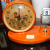 Day Date Calender Art Deco metal Alarm clock with Waving Hand  & Airplane ???