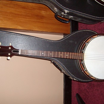 4 string banjo - Guitars