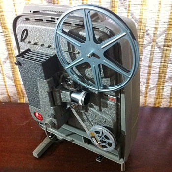 Revere 777 8mm movie projector - Cameras
