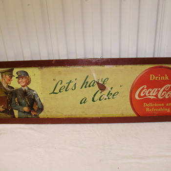cardboard sign coca cola