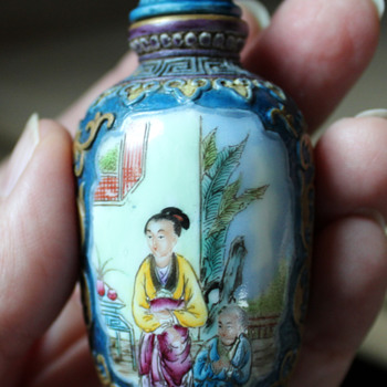 Famille Rose Molded Porcelain Snuff Bottle