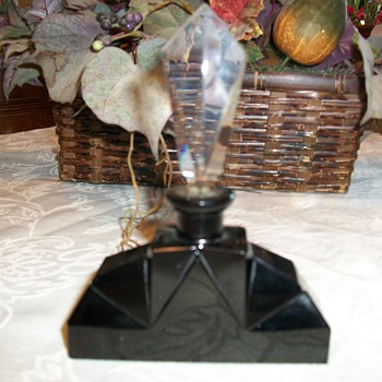 Opaque black and clear stopper perfume bottle