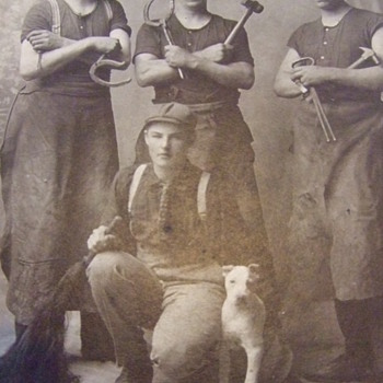 Photo of Blacksmiths with apprentice and dog  c. 1895 - Photographs
