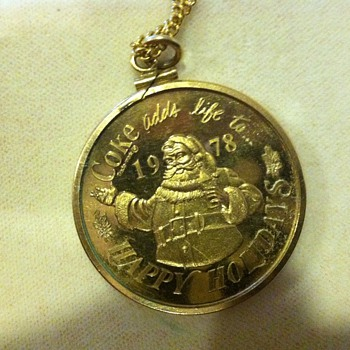 1978 coca cola Santa and present pendent