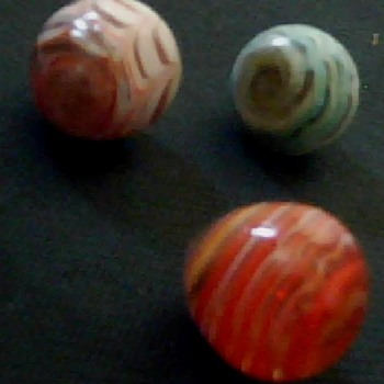 odd and rare marbles first are hand blown webbed horiz. lines w / white core. next is a perfect stone tigers eye, last for now