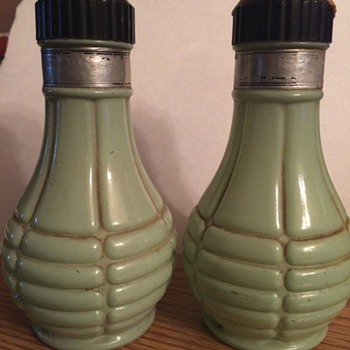 Old black and green salt and pepper shakers