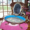 brass ornate mirror with painted tray  from worlds fair
