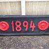 """1894"" metal sign"