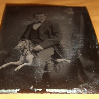 Tintype of man on carved rocking horse