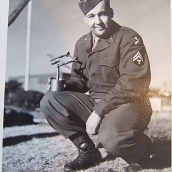 Snapshot of soldier holding Trench Art P-38 - Military and Wartime