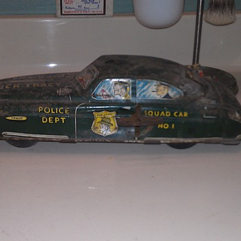 Old, dirty, beat up Dick Tracy Car