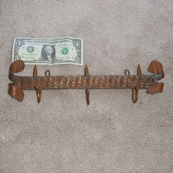 Trench art coat rack