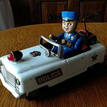 The happy little policeman in his convertible....yup convertible
