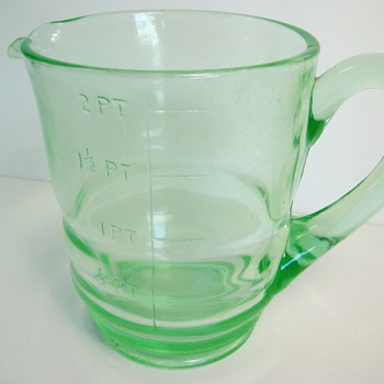 Help identify this large Vaseline Glass Measuring Pitcher