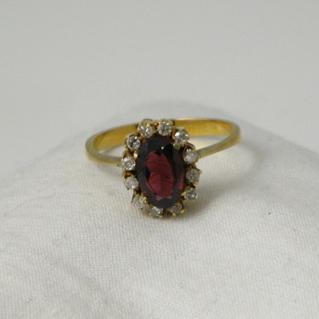Oval Garnet and Diamond Ring