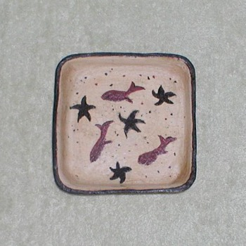 Square pottery bowl