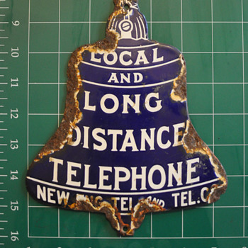 New Eng Tel. and Tel. Co. die-cut Local and Long Distance Bell - Telephones