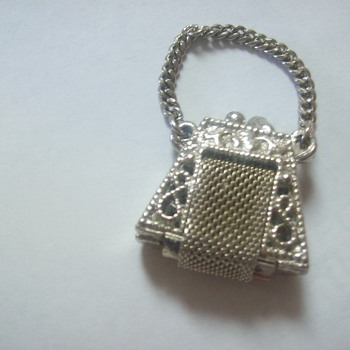 tiny metal handbag piece