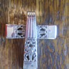 Home Made Sterling cross from Ster. Silverware? and not sterling stretch cheap but cute Religious bracelet!