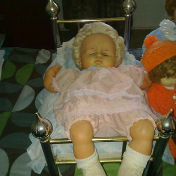 Dolls from 1950's one with her original bed