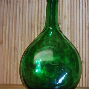 hand blown glass flask, or demijohn bottle